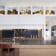 View of contemporary kitchen with wooden island and cabinetry, countertop, cuisine classique, interior design, kitchen, white, gray