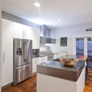 View of contemporary renovated kitchen featuring timber floors, countertop, interior design, kitchen, property, real estate, room, gray