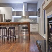 View of contemporary renovated kitchen featuring timber floors, cabinetry, countertop, cuisine classique, floor, flooring, hardwood, interior design, kitchen, laminate flooring, real estate, room, wood, wood flooring, gray