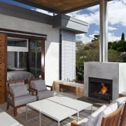 View of patio area which features outdoor chairs hearth, house, interior design, living room, outdoor structure, patio, real estate, table, brown, white