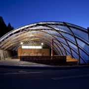 View of the canopy at the Waitomo Caves arch, architecture, building, corporate headquarters, daylighting, evening, facade, fixed link, landmark, metropolitan area, night, residential area, sky, structure, black, blue