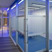 Interior view of offices which features glass cavity architecture, glass, blue, gray