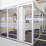 Interior view of offices which features glass cavity door, glass, window, white