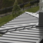 View of the roofing by Roofing Industries - architecture, daylighting, deck, handrail, house, line, outdoor structure, roof, stairs, gray, black, brown
