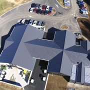 View of the roofing by Roofing Industries - architecture, house, real estate, residential area, roof, gray
