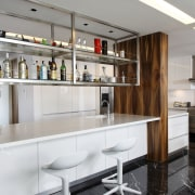 View of a bar style kitchen which features cabinetry, countertop, cuisine classique, interior design, kitchen, gray