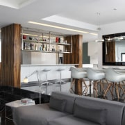 View of a bar style kitchen which features architecture, ceiling, furniture, interior design, living room, table, gray, black