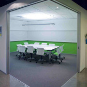 Interior view of offices which features glass cavity architecture, ceiling, daylighting, glass, interior design, office, product design, table, wall, gray