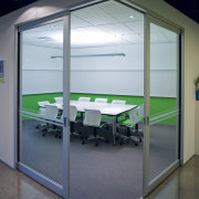 Interior view of offices which features glass cavity architecture, door, glass, office, window, gray, black