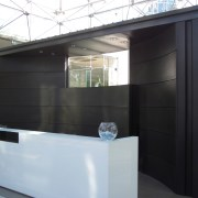 View of brass walls fabricated by Craft Metals architecture, glass, black, gray