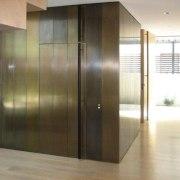 View of brass walls fabricated by Craft Metals door, floor, flooring, glass, hardwood, interior design, property, real estate, wall, wood, wood flooring, brown, white