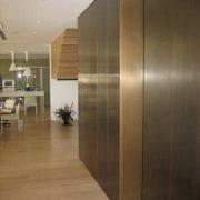 View of brass walls fabricated by Craft Metals cabinetry, floor, flooring, furniture, hardwood, interior design, laminate flooring, wall, wood, wood flooring, brown