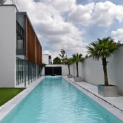 View of the outdoor area which features a architecture, condominium, estate, home, house, leisure, property, real estate, resort, sky, swimming pool, villa, water, gray, teal