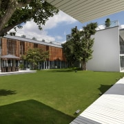 Exterior view of home with timber louvres, grassed architecture, backyard, courtyard, estate, facade, grass, home, house, lawn, plant, property, real estate, residential area, villa, yard, brown