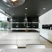 View of minimalist kitchen which features black granite cabinetry, countertop, interior design, kitchen, product design, white, black