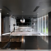 View of minimalist kitchen which features black granite architecture, ceiling, countertop, floor, interior design, kitchen, product design, black, gray