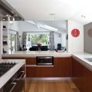 View of kitchen which features oak floors, kitchen countertop, interior design, kitchen, real estate, white