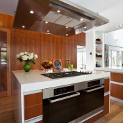 View of kitchen which features oak floors, kitchen cabinetry, countertop, cuisine classique, interior design, kitchen, room, brown, white