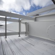 View of the cantilevered roof of the South architecture, daylighting, floor, home, house, real estate, roof, gray