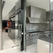 View of the wet kitchen which features stainless glass, interior design, kitchen, gray, white