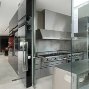 View of the wet kitchen which features stainless glass, interior design, kitchen, gray