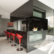 View of kitchen which features granite wall panels, interior design, table, white