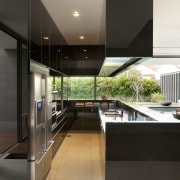 View of kitchen which features granite wall panels, architecture, countertop, house, interior design, real estate, black