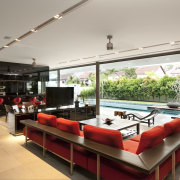 View of lounge which features red sofas, flat interior design, living room, real estate, table, gray