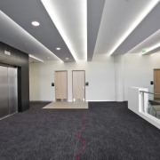 Singer Group undertook the broad array of electrical ceiling, daylighting, floor, flooring, interior design, lobby, gray, black