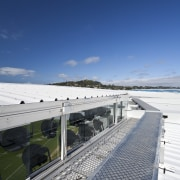 View of the roof of the south stand architecture, cloud, daytime, fixed link, horizon, road, sea, sky, water, blue