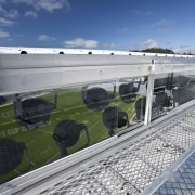 View of the roof of the south stand architecture, cloud, fixed link, reflection, roof, sky, structure, water, gray, blue