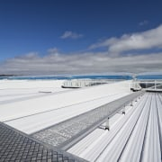 View of the roof of the south stand cloud, coastal and oceanic landforms, daylighting, daytime, fixed link, horizon, line, ocean, pier, roof, sea, sky, vacation, water, gray, blue