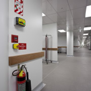 View of fire prevention and suppression systems at ceiling, floor, interior design, product design, gray