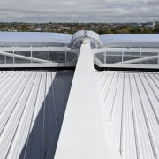 View of the cantilevered roof of the South architecture, daylighting, fixed link, roof, sky, water, white
