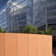 view of Eden Park which features precast concrete architecture, building, corporate headquarters, daylighting, facade, line, structure, orange