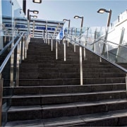 View of stairway with stainless steel handrails at building, daylighting, facade, guard rail, handrail, iron, metropolitan area, stairs, steel, structure, black, gray