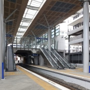 View of the railway tracks at the upgraded building, metro station, metropolis, metropolitan area, public transport, rapid transit, structure, track, train station, transport, gray, black