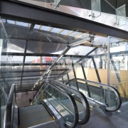 View of the renovated New Lynn Railway Station architecture, building, escalator, glass, metropolitan area, motor vehicle, public transport, structure, transport, black, gray