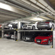 View of the underground car parking at the automobile repair shop, automotive design, automotive exterior, automotive wheel system, car, executive car, garage, luxury vehicle, motor vehicle, parking, parking lot, vehicle, gray