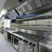 View of a kitchen at Eden Park which kitchen, gray, black
