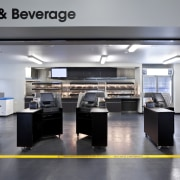 View of the front-of-house of a kitchen at interior design, kitchen, office, gray, black