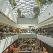 Surrounding the gardens is a multi-level retail marketplace architecture, building, ceiling, commercial building, daylighting, interior design, mixed-use, real estate, retail, roof, shopping mall, gray