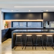 Designer Kirsty Davis created a minimal, balanced kitchen architecture, building, cabinetry, ceiling, countertop, floor, flooring, furniture, home, house, interior design, kitchen, lighting, living room, material property, property, real estate, room, table, gray