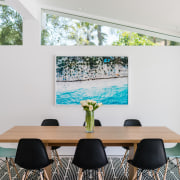 Clerestory windows bring additional light into the dining