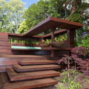 View of timber outdoor seating area with large backyard, home, house, outdoor structure, plant, tree, wood, red
