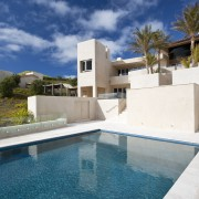 Exterior view of Mediterranean styled house which is apartment, architecture, estate, home, house, property, real estate, residential area, resort, sky, swimming pool, villa, blue