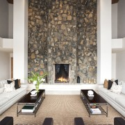 View of symmetrical living area with twin sofas ceiling, fireplace, floor, flooring, hearth, interior design, living room, room, wall, white, brown