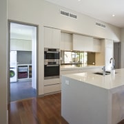 View of large, open renovated kitchen featuring timber countertop, cuisine classique, floor, interior design, kitchen, real estate, gray