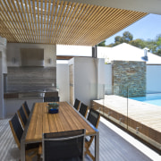 View of outdoor area which features decking, timber architecture, daylighting, house, interior design, property, real estate, roof, gray