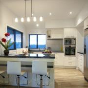 View of the kitchen at David Reid show countertop, interior design, kitchen, real estate, room, orange